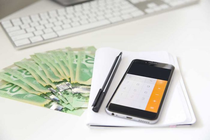 Calculator on iPhone with some Canadian bills